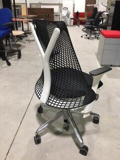 Black Herman Miller Sayl chair with white frame