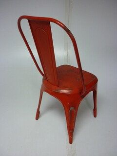 Tolix style red metal dining chair