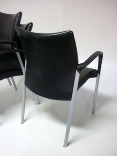 Black leather Senator Trillipse stacking chairs